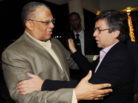 Finance Minister Peter Phillips (left) with  President of the Inter-American Development Bank, Luis Alberto Moreno at the Jamaica Pegasus Hotel shortly after the IDB head arrived in Jamaica - Ricardo Makyn/Staff Photographer