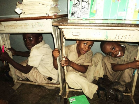Pratville Primary & Infant School students in Manchester take cover during an earthquake drill - Contributed Photo