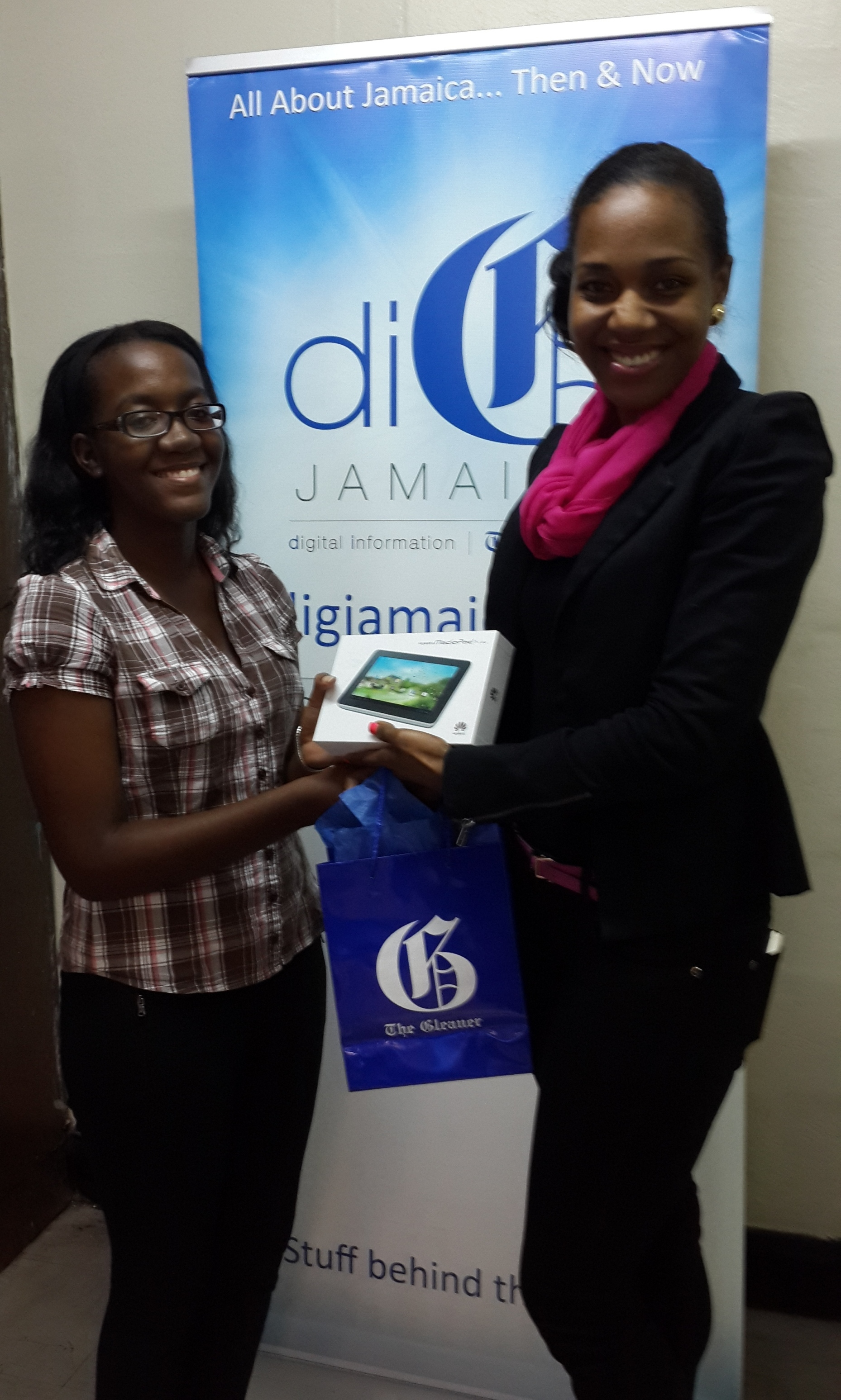 winning essay at a true democracy dig blog danniel brown left collects her prize from terri karelle reid brand manager gleaner online democracy is a form of government