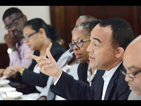 Health Minister Dr Christopher Tufton (second right) addresses a Gleaner Editors' Forum held yesterday at the newspaper's North Street, Kingston offices. With Tufton are (from left) Myron Smith, president of the Medical Association of Jamaica; Dr Jacqueline Bisasor-McKenzie, director, Emergency Medical Services; Dr Sonia Copeland (partially hidden), director, Health Promotion and Protection Unit; Elaine Foster-Allen, permanent secretary in the health ministry; and Dr Lundie Richards, director, health service planning and integration.