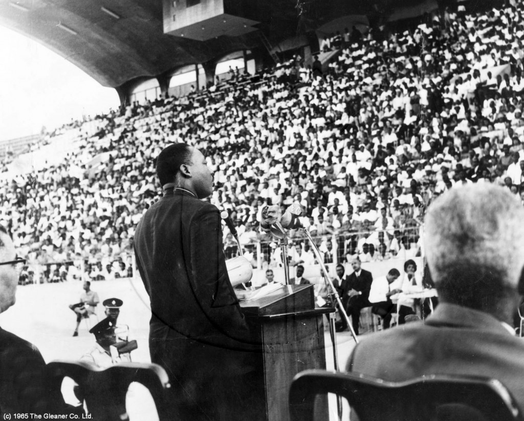 Reverend Dr. Martin Luther King Jr. in Jamaica Dr. King addresses a large crowd at the National Stadium after receiving the keys to the city of Kingston, presented by the Commissioner of the KSAC, Mr. Eustace Bird. -Gleaner Photo