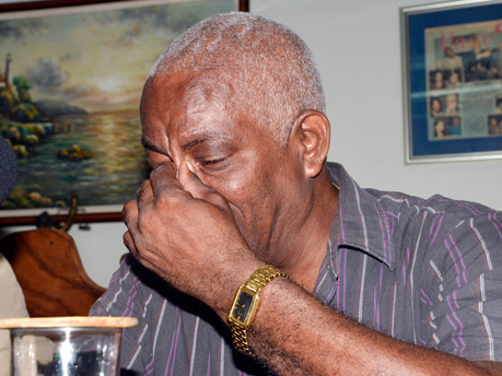 Nicholas Deane, father of Mario Deane, who died days after a police lock-up beating, came to tears at a press conference in Kingston yesterday.