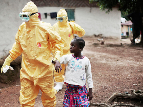 Nine-year-old Nowa Paye is taken to an ambulance after showing signs of the Ebola infection in the village of Freeman Reserve, Liberia, on Tuesday.  - AP