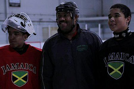 Graeme Townshend flanked by two members of Jamaica's team