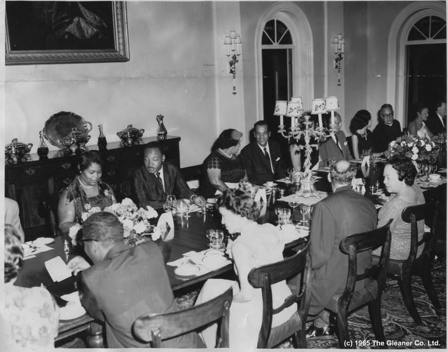 The Gleaner FOLLOWING THE VALEDICTORY SERVICE at the University, their Excellencies the Governor General, Sir Clifford Campbell, and Lady Campbell gave a dinner at King's House in honour of the Rev. Dr. Martin Luther King, Jr., Mrs King and the Rev. Bernard Lee. Dr. King is seated second from left facing camera. In the same row from left are: Senator Mrs. Esme Grant, Lady Campbell, the Hon. D. C. Tavares, Mrs Douglas Fletcher, the Hon. V. N. Aguilar, Mrs. C. A. M. Moody, the Rev. Hugh Sherlock, Mrs. Donald Fitz-Ritson and Mr. L. O. Ramson. From left with back to camera are: Mrs Sherlock the Rev. Lee, Mrs. Aguilar, Senator Douglas Fletcher and Mrs. F. R. Duhaney. The other guests were the Hon. Edward Seaga, Senator Dr. Ronald Irvine and Mrs. Irvine, the Rev. Canon R. O. C. King and Mrs. King, Professor and Mrs. John Golding, Lt. Col. C. A. M. Moody, Dr. and Mrs. Hugh Springer, Mr Donald Fitz-Ritson, Mr. Milton Rodriques, Mr. T. E. Sealy, Mr and Mrs. Leacroft Robinson, Miss Clair Campbell, Mr and Mrs A. W. Powell, Capt. R. E. C. Lewis, the ADC and Capt N.A. Ogilvie, extra ADC.